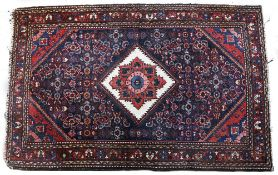 A PERSIAN, BAKTIARI STYLE BLUE AND RED GROUND SMALL RUG with a white diamond central motif on a