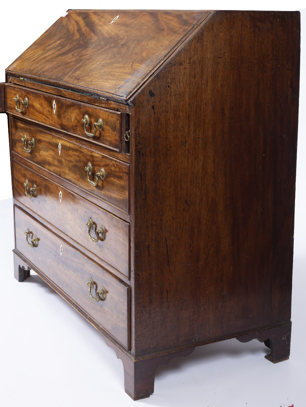 A GEORGE III MAHOGANY BUREAU, the fall front enclosing fitted interior, above four long graduated - Image 4 of 6