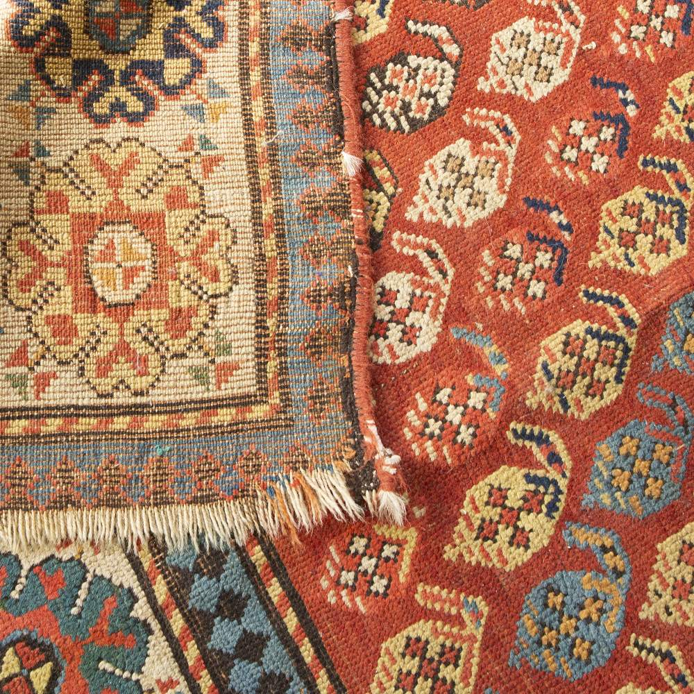 A PERSIAN RUNNER woven with diagonal rows of botehs on a rust coloured ground within a border filled - Image 2 of 2