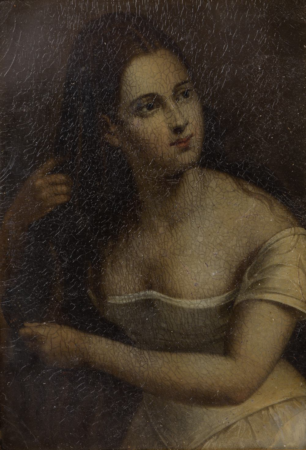 A 19TH CENTURY PAPIER-MACHE PANEL painted with female beauty attending to her long hair, 8 x 5.5cm