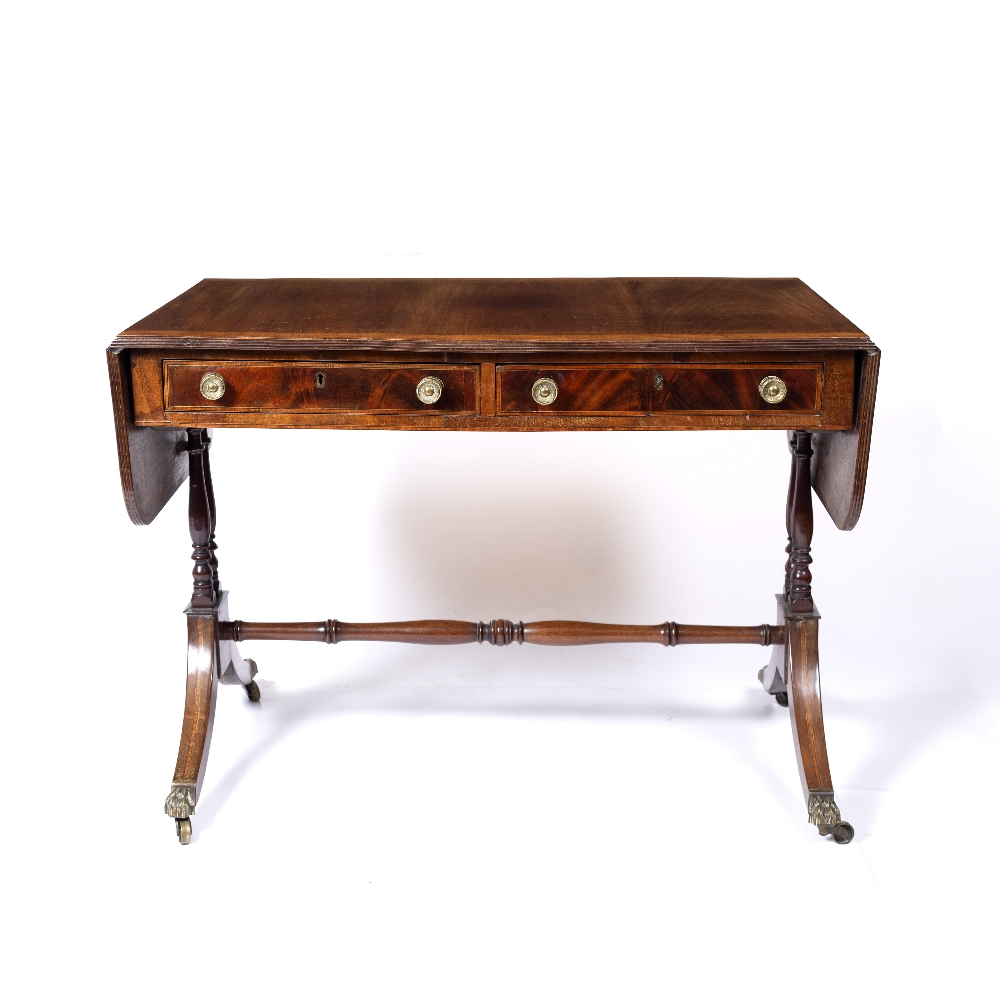 A REGENCY MAHOGANY SOFA TABLE, the top with a satinwood banded edge above two frieze drawers, twin