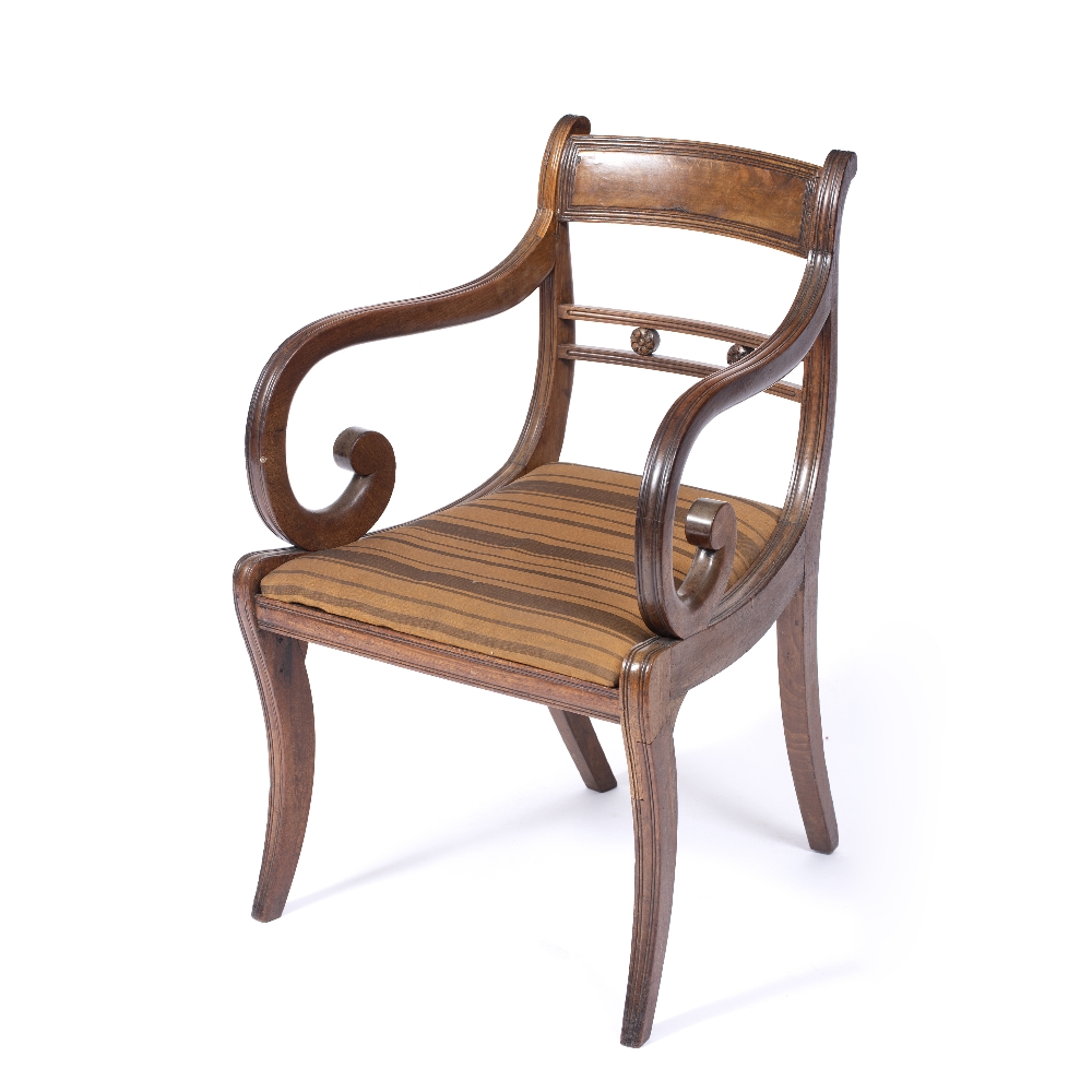 A REGENCY MAHOGANY OPEN ARM ELBOW CHAIR, the horizontal centre rail with carved florettes,