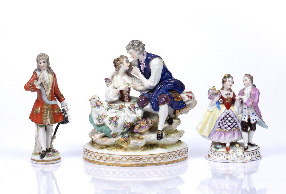 A CONTINENTAL PORCELAIN FIGURE GROUP, of a courting couple, on gilt heightened oval base, 18cm high;