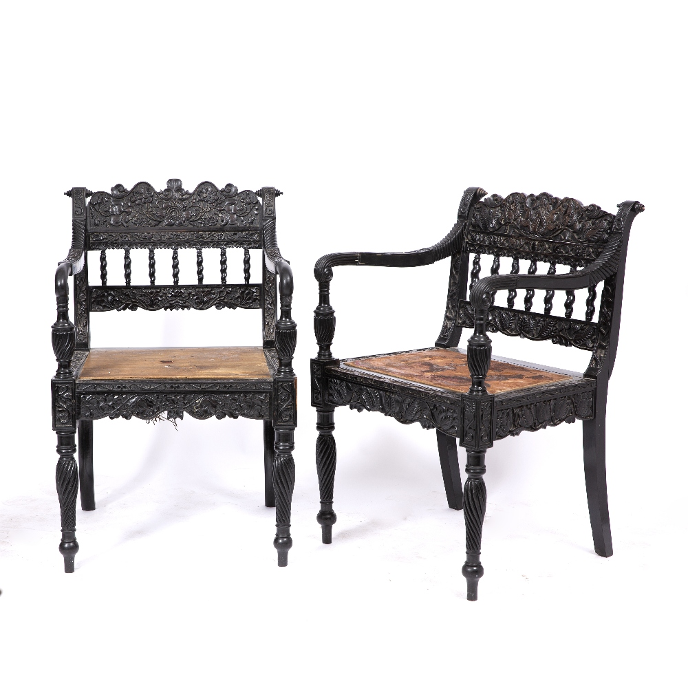 A NEAR PAIR OF EARLY 19TH CENTURY CEYLONESE CARVED EBONY OPEN ARMCHAIRS the foliate crest rails over - Image 2 of 8