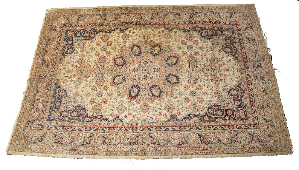 AN OLD TURKISH SIVAS RUG decorated with a central radiating foliate medallion in pastel colours, 190
