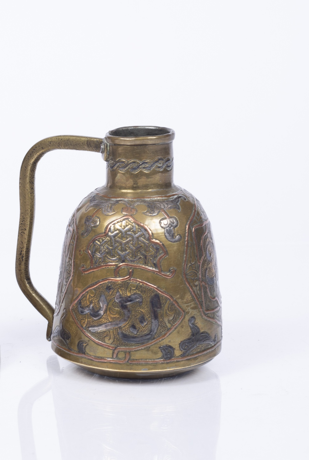 AN OLD ISLAMIC SILVERED, COPPER AND BRASS JUG chased and engraved with arabic calligraphy and formal - Image 2 of 2