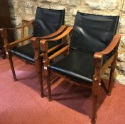 A PAIR OF SAFARI CHAIRS in the manner of Michael Hirst, with padded backs and seats, leather elbow