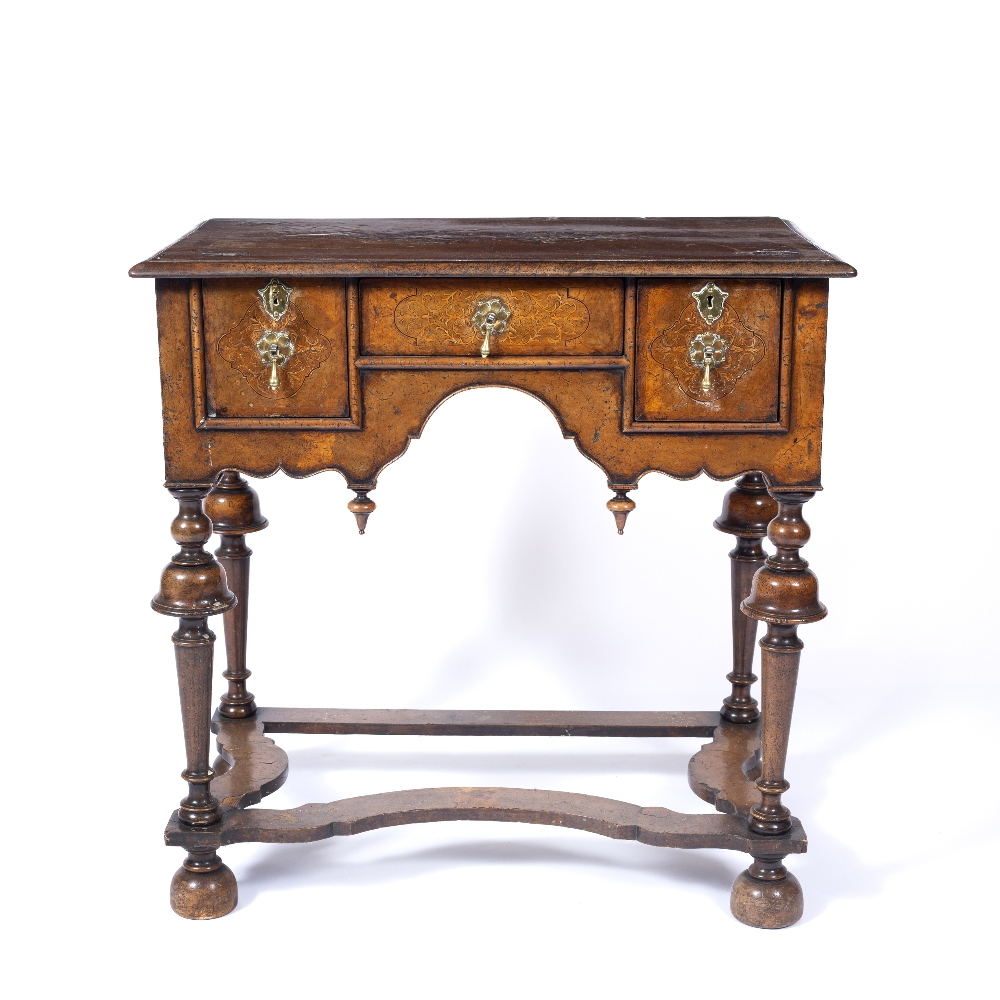 AN 18TH CENTURY STYLE WALNUT AND INLAID LOWBOY, the top and drawers with foliate marquetry angles,
