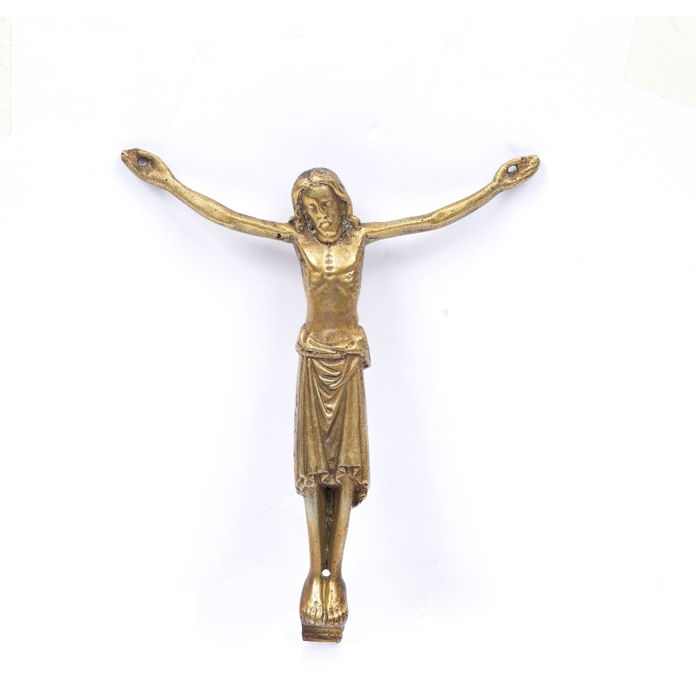A BRONZE CORPUS CHRISTI cast and chased in the Romanesque style, holes for attachment, probably