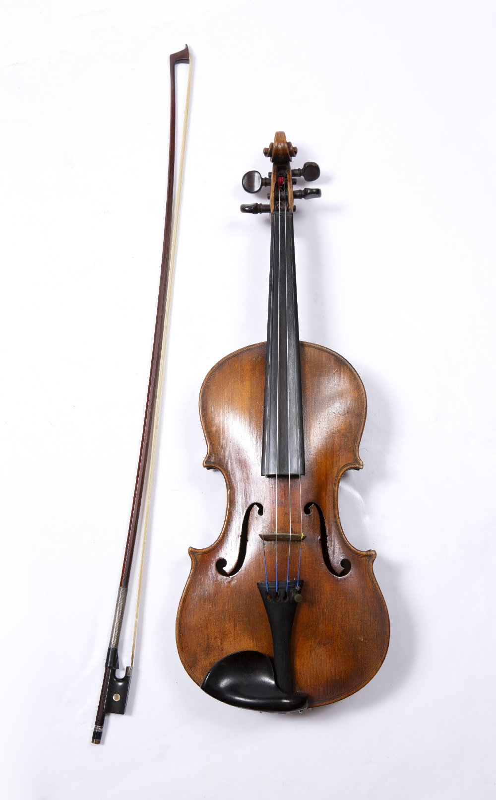 A LATE 19TH CENTURY GERMAN VIOLIN with two piece back, back length 36cm; with German bow, in