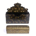 A 19TH CENTURY PERSIAN PEN BOX with domed cover and all over gilt foliate decoration, 26cm wide