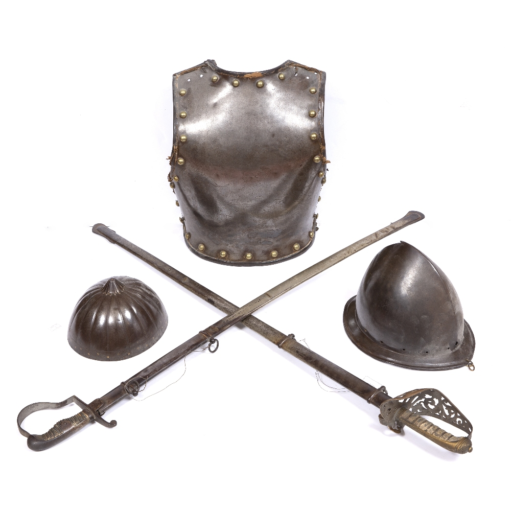 AN ANTIQUE STEEL BREAST PLATE with brass studs and leather trimmed rim, 41cm high, a Saxon style