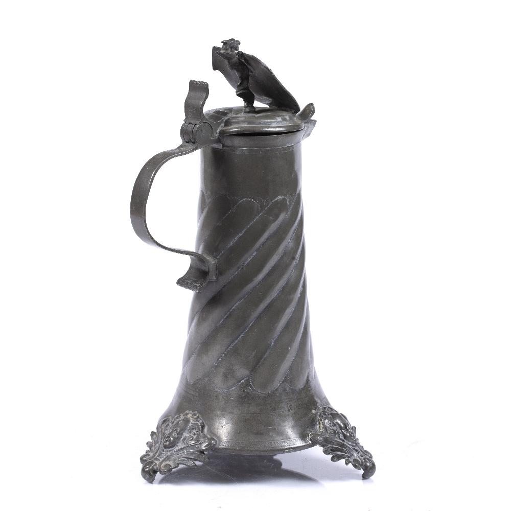 A GERMAN PEWTER FLAGON the hinged lid with heraldic crest, scroll handle, wrythen and wrigglework - Image 2 of 3