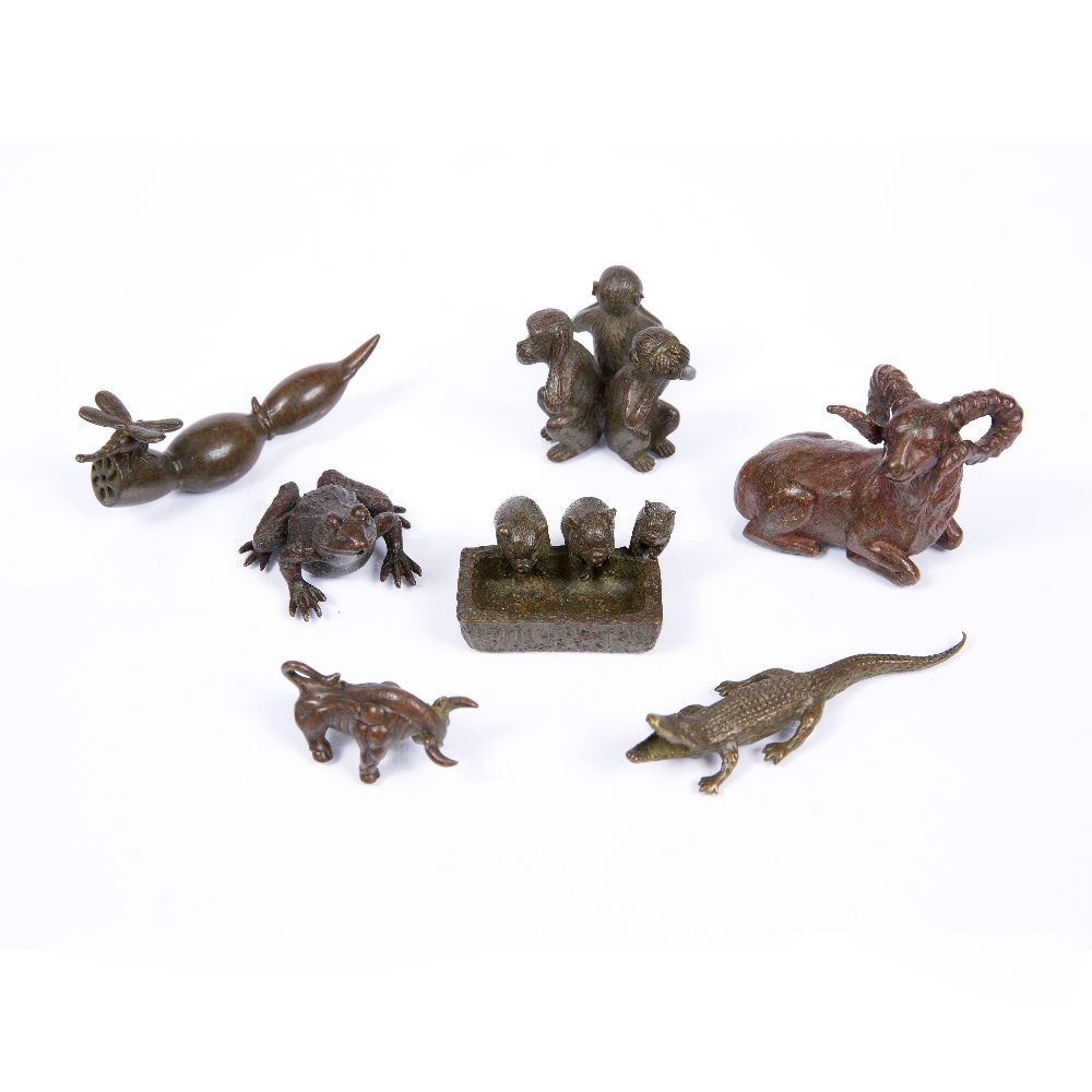 A BRONZE MINIATURE FIGURE OF A RECUMBENT RAM, together with a collection of further animals