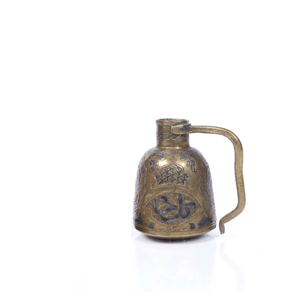 AN OLD ISLAMIC SILVERED, COPPER AND BRASS JUG chased and engraved with arabic calligraphy and formal