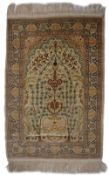A TURKISH, HEREKE STYLE, SILK MAT decorated trees and flowers in pastel colours, 100 x 70cm