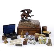 A COLLECTION OF OBJECTS including a carved wood griffin, two millefiori glass paperweights, a pietra