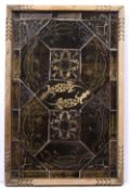 A BENIN TILE PANEL decorated with lizards and stylised fish, mounted within a wooden rectangular