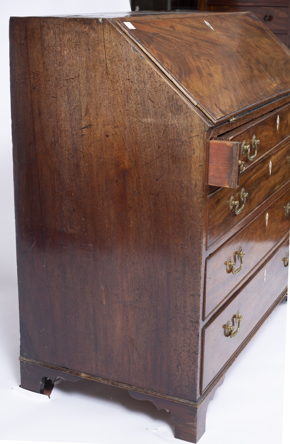 A GEORGE III MAHOGANY BUREAU, the fall front enclosing fitted interior, above four long graduated - Image 5 of 6