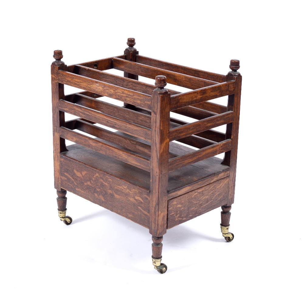 A 19TH CENTURY OAK CANTERBURY with slatted divisions, end drawer, turned legs, brass terminals,