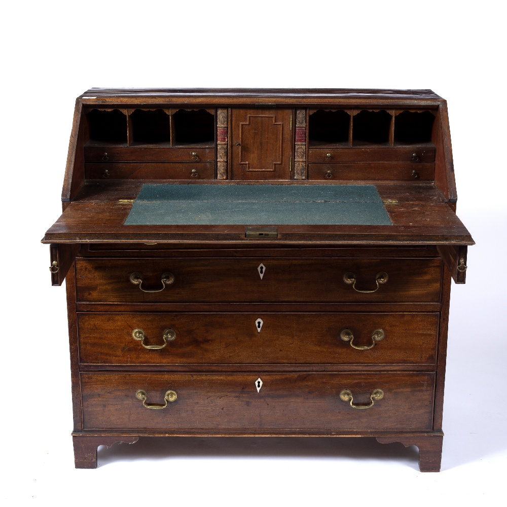 A GEORGE III MAHOGANY BUREAU, the fall front enclosing fitted interior, above four long graduated