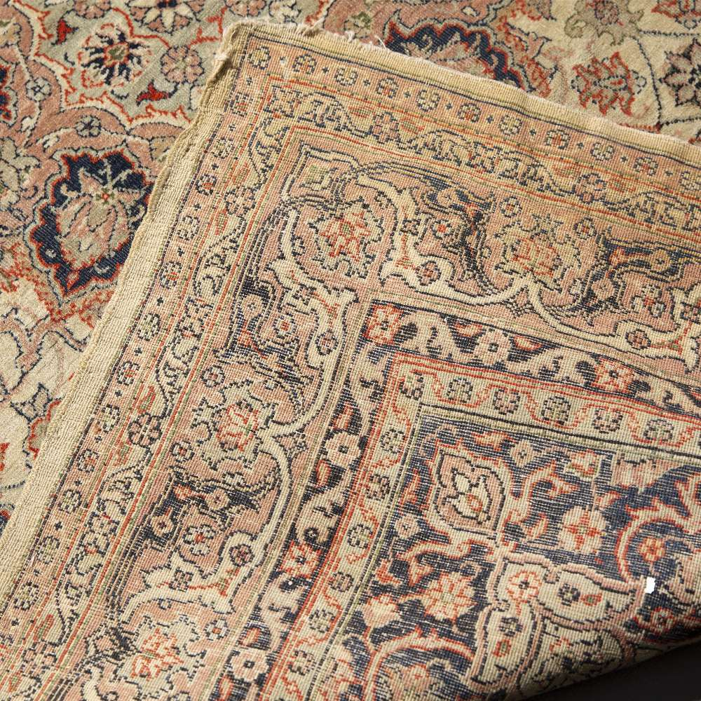 AN OLD TURKISH SIVAS RUG decorated with a central radiating foliate medallion in pastel colours, 190 - Image 2 of 2
