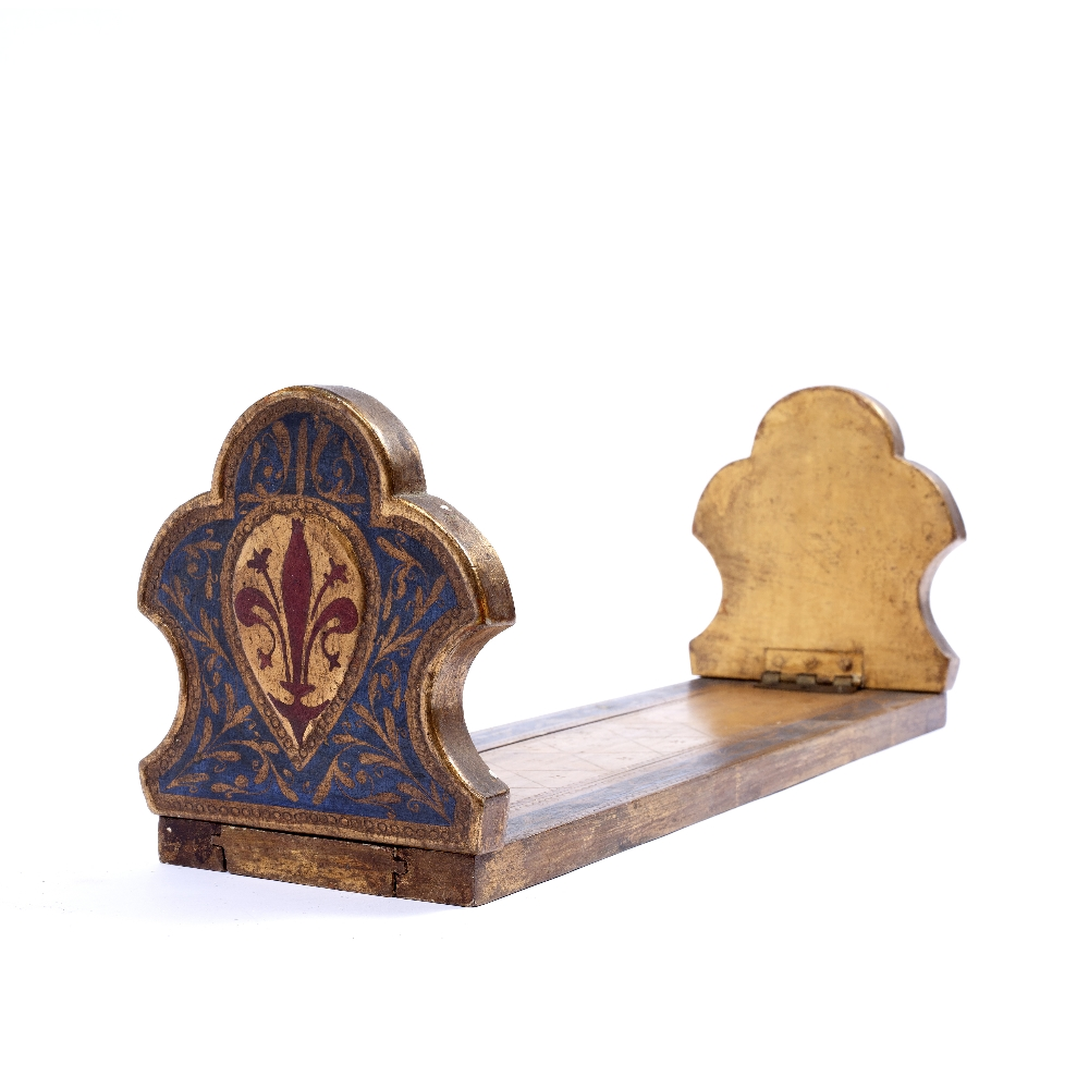 A BLUE AND GILT PAINTED EXTENDING BOOK STAND with fleur de lys ornament, 380mm long closed