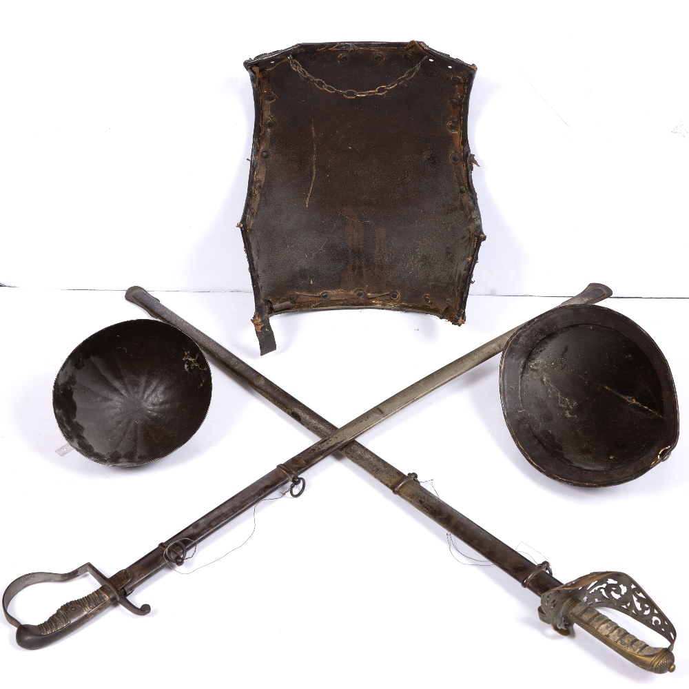 AN ANTIQUE STEEL BREAST PLATE with brass studs and leather trimmed rim, 41cm high, a Saxon style - Image 2 of 4