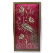 A DECORATIVE WALL HANGING PANEL embroidered with peacock upon a flowering branch similar to the