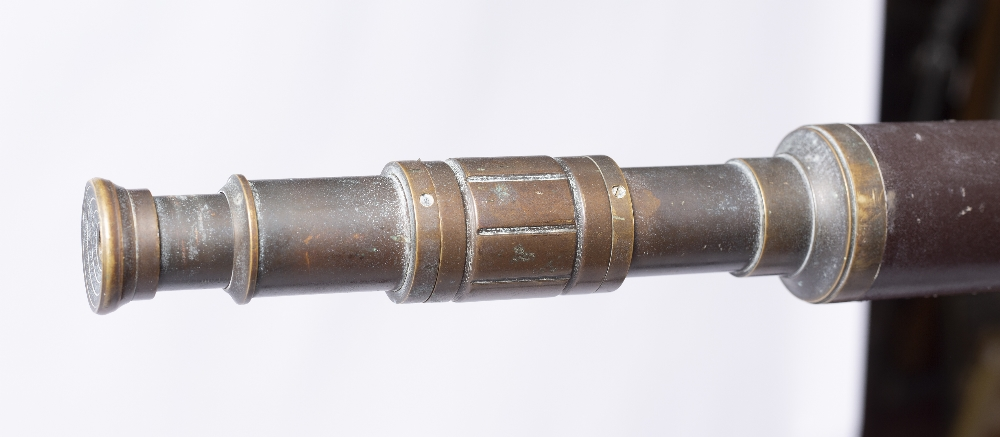 A VICTORIAN LEATHER AND BRASS TELESCOPE with single telescopic draw adjusting by a collar, upon a - Image 3 of 4