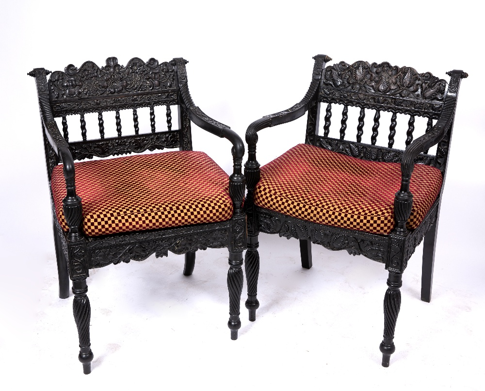 A NEAR PAIR OF EARLY 19TH CENTURY CEYLONESE CARVED EBONY OPEN ARMCHAIRS the foliate crest rails over - Image 8 of 8