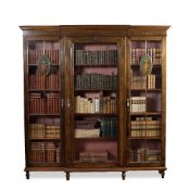 A MAHOGANY BREAKFRONT BOOKCASE IN SHERATON REVIVAL STYLE the moulded cornice with hand painted