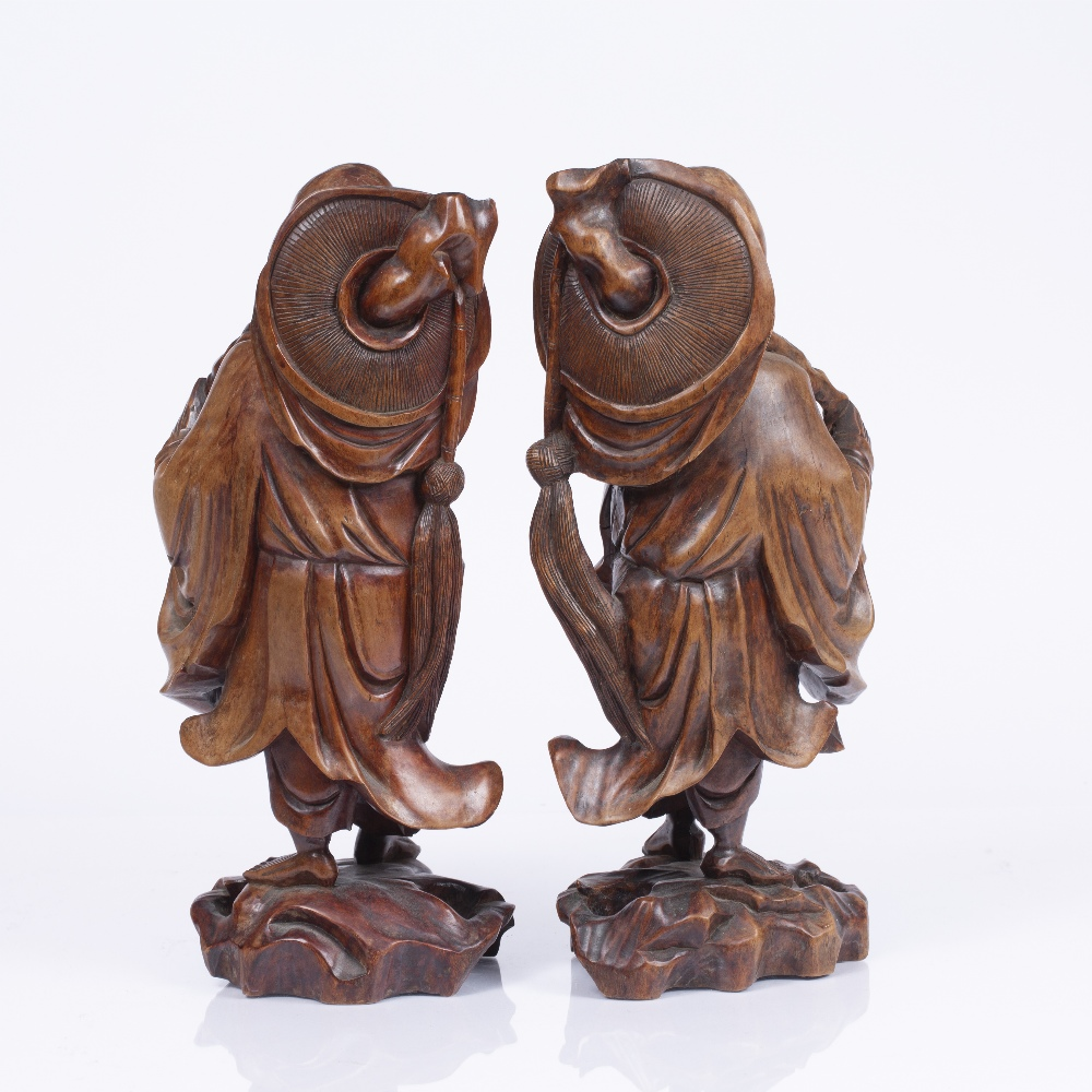 A PAIR OF CHINESE CARVED ROOT FIGURES, each in the form of a robed figure with glass inset eyes, - Image 2 of 3