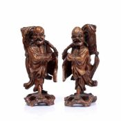 A PAIR OF CHINESE CARVED ROOT FIGURES, each in the form of a robed figure with glass inset eyes,