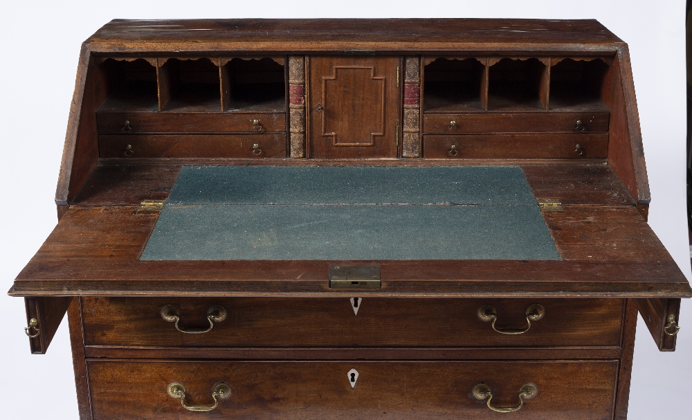 A GEORGE III MAHOGANY BUREAU, the fall front enclosing fitted interior, above four long graduated - Image 2 of 6