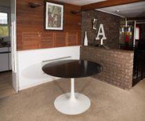 Eero Saarinen (1910-1961) for Arkana Dining table extending black ash top over white enamelled
