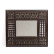 Attributed to Liberty & Co. Moorish style mirror, circa 1900 mirror within square beaded frame 60