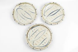 Michael Cardew (1901-1983) at Wenford Bridge Set of three plates with blue leaf motifs and brown