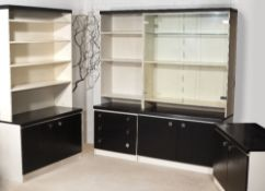 Arkana Quatro storage system, 1974 comprising two black ash and glazed cabinets with matching base