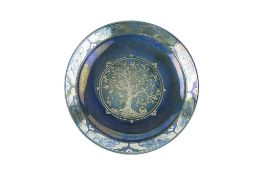 Jonathan Chiswell Jones (b.1944) Tree of life plate reduction fired lustre on blue ground painted