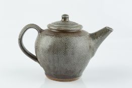Phil Rogers (1951-2020) Teapot blue and brown glaze, the body with incised diagonal lines