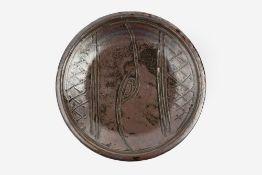 Michael Cardew (1901-1983) at Wenford Bridge Dish iron glaze with incised line decoration