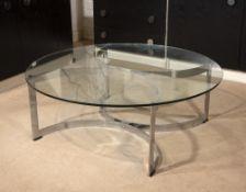 Italian School Coffee table, circa 1960 the circular glass top over elliptical chrome base 32cm