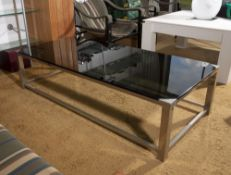 1960s School Coffee table chrome and smoked glass 35cm high, 140cm long, 65cm wide. Provenance: