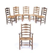 Gordon Russell (1892-1980) A set of six Cotswold School dining chairs oak with ladderbacks and