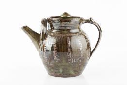 Michael Cardew (1901-1983) at Wenford Bridge Teapot layered iron glazes on green ash glaze impressed