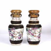 A pair of late 19th century Chinese Famille Rose crackle glazed vases each 26cm in height, each with