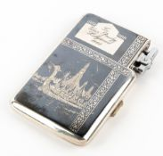 Elvis Presley interest - A Thai white metal combination cigarette case and lighter, given as a