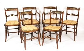 A set of six Edwardian rosewood and brass inlaid chairs with caned seats and turned supports, to