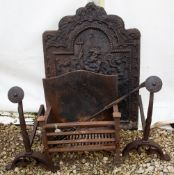 An antique cast iron fire grate, 42cm wide x 26cm deep x 45cm high together with a pair of antique